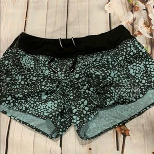 Nike Dri-fit teal and black running shorts